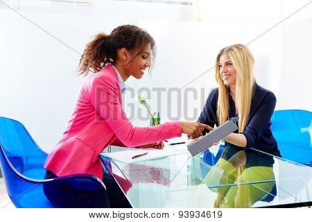 businesswomen interview meeting multi ethnic african and blond sitting at office
