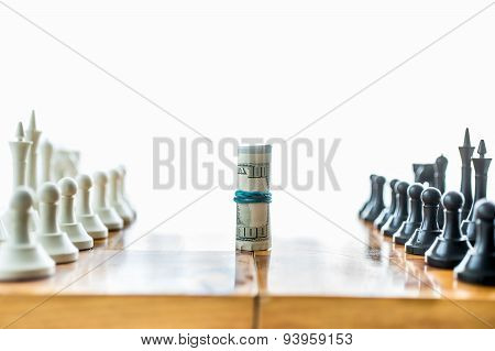 Twisted Money On Board Between Rows Of Chess Pieces