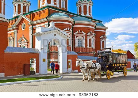 KOLOMNA, RUSSIA - MAY 03, 2014: Horse-drawn carriages (omnibus) in Kolomna Kremlin - Russia - Moscow region.
