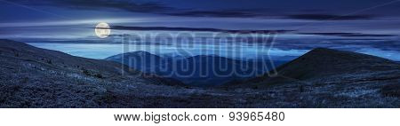 Panorama Of Hillside With Stones In High Mountains At Night