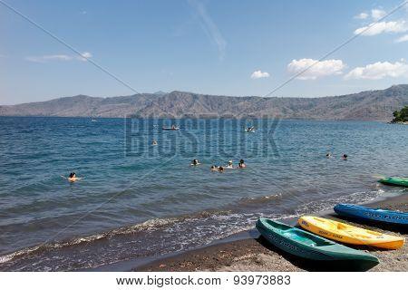 Laguna De Apoyo, Nicaragua- March 28 2015: People Swimming In Lake And Kayaks Around
