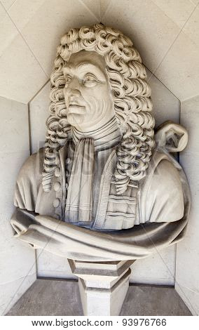 A sculpture of famous architect Sir Christopher Wren situated outside Guildhall Art Gallery in London. poster