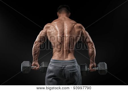 Strong Bodybuilder Doing Exercises With Dumbbells Turned Back
