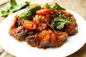 phad phed pla duk thod krob (stir fried deep fried catfish with curry paste) thai food. poster