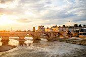 View on Stone bridge from Oko bridge in Skopje on sunset poster