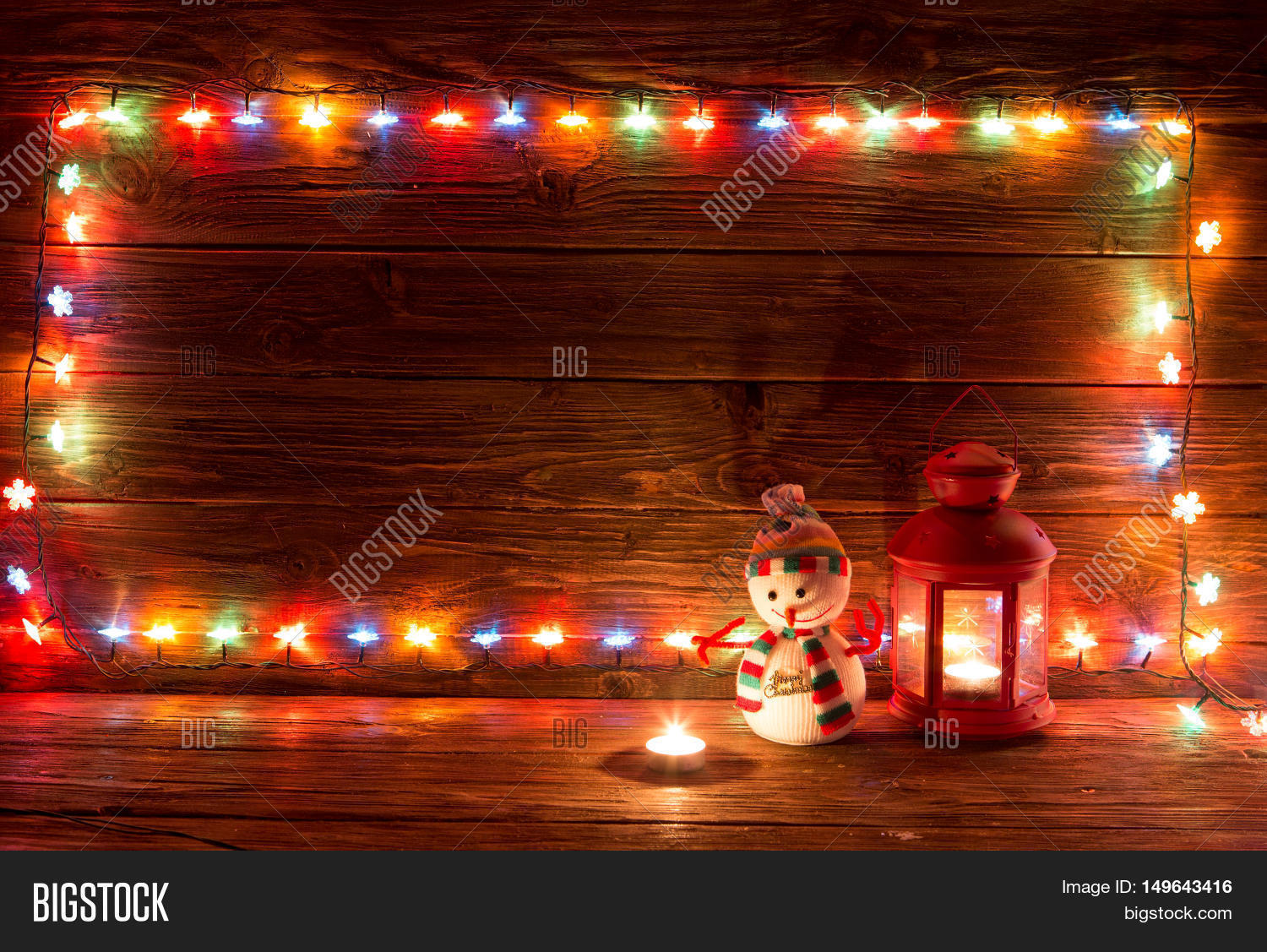 Christmas Lights And Vintage Lantern On Wooden Background