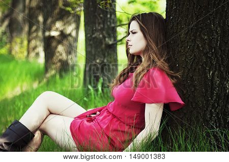 Young Beautiful Girl In A Pink Coat And Pink Short Dress Boots R