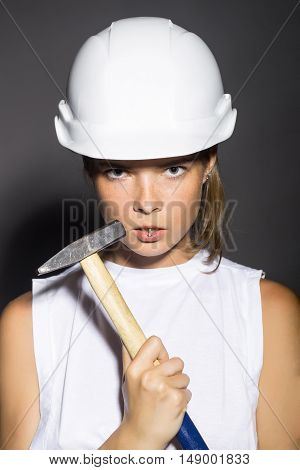 Young Woman With Hard Hammer