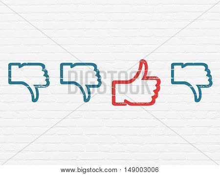 Social network concept: row of Painted blue thumb down icons around red thumb up icon on White Brick wall background