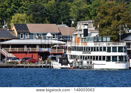 LAKE GEORGE, NY - SEP 24: Cruises around Lake George in New York State, as seen on Sep 24, 2016. The lake lies within the upper region of the Great Appalachian Valley and drains all the way northward into Lake Champlain and the St. Lawrence River drainage