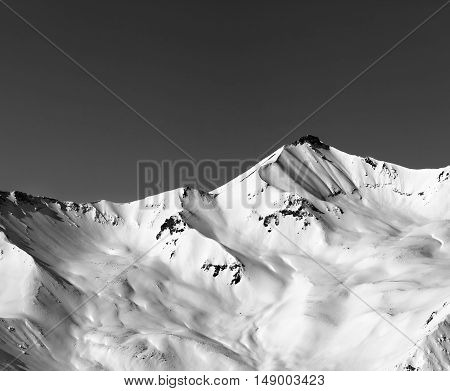 Black And White Off-piste Snowy Slope In Winter Mountain
