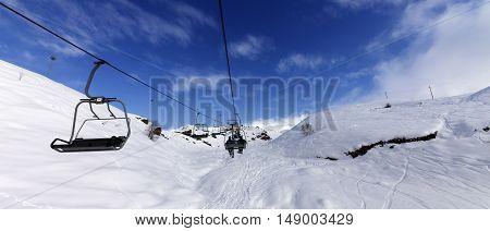 Panoramic View On Chair-lift At Ski Resort At Sun Winter Day