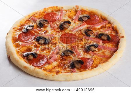 pizza ham mushrooms pepperoni pizza on a white background close-up side view isolated
