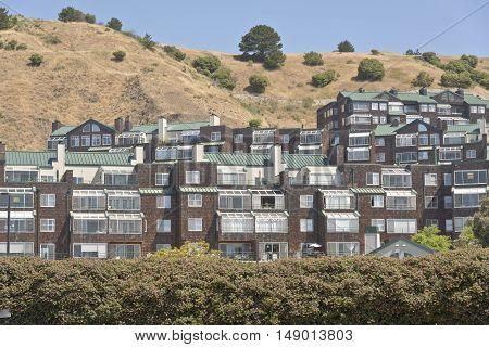 Houses and condominiums in a hillside Richmond California.