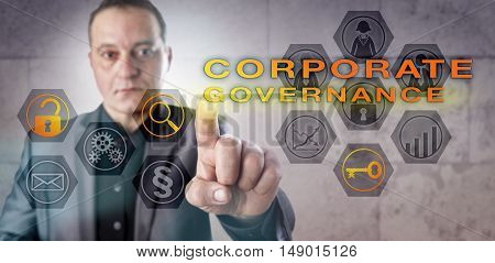 Experienced executive identifying a CORPORATE GOVERNANCE issue on a control screen. Business concept touching on corporate law accountability management accounting fraud and corporate finance.