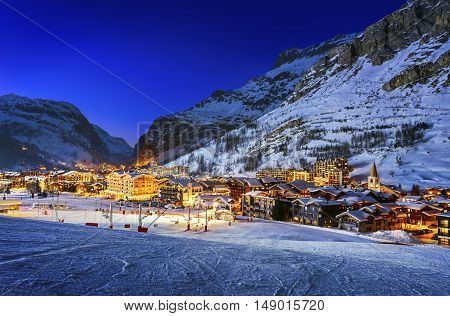 Famous and luxury place of Val d'Isere at sunset Tarentaise Alps France
