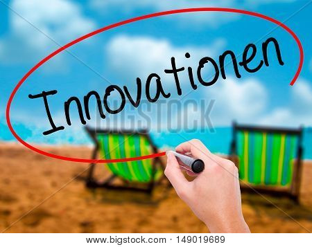 Man Hand Writing Innovationen  (innovationin German)t With Black Marker On Visual Screen