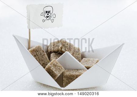 Brown sugar cubes in a paper boat