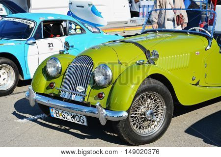 CLUJ-NAPOCA ROMANIA - SEPTEMBER 24 2016: Vintage Morgan Plus 4 roadster classic car made by the Morgan Motor Company from 1950 to 1969 in parking lot.