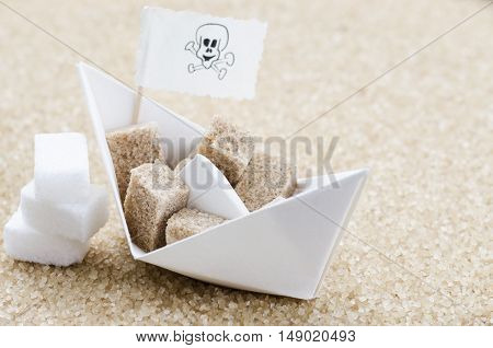 White and brown sugar cubes and boat
