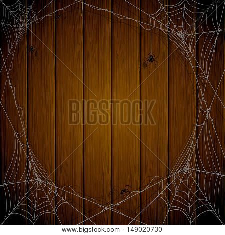 Halloween theme, dark wooden background with cobwebs and black spiders, illustration.