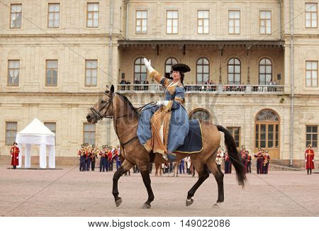 GATCHINA, ST. PETERSBURG, RUSSIA - SEPTEMBER 10, 2016: Actress in image of Empress Catherine II on a horse during the festival Gatchinskaya Byl. The festival is held first time this year