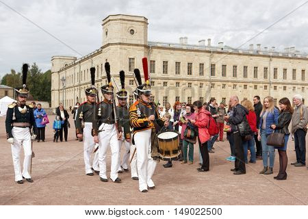 GATCHINA, ST. PETERSBURG, RUSSIA - SEPTEMBER 10, 2016: Guards with military drummer on the platz in front of Gatchina palace during the festival Gatchinskaya Byl. The festival is held first time