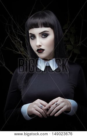 Fashion portrait of mysterous gothic young girl