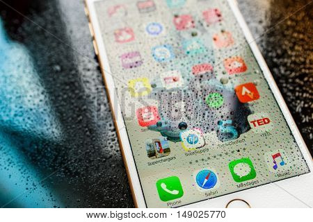 PARIS FRANCE - SEP 26 2016: New Apple iPhone 7 Plus unboxing and testing - home screen with apps under rain . New iPhone7 is one of the best waterproof smart phone in the world