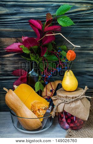 Fall Still Life with Pumpkins cornucopia and fresh fruits. Vertical Composition.