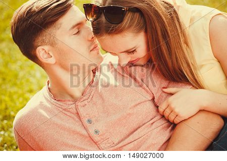 Love romance relationship dating relax concept. Affectionate couple on grass. Young enamoured girl and boy show affection in park.