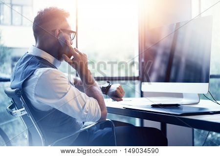 Bearded Businessman Wearing White Shirt Waistcoat Working Modern Loft Startup Computer.Creative Young Man Using Mobile Phone Call Partner Meeting.Gentleman Guy Looking Watch Workplace.Blurred Flares