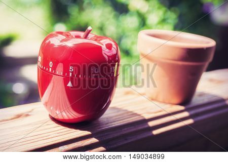 5 Minute Kitchen Egg Timer In Apple Shape Standing On A Handrail