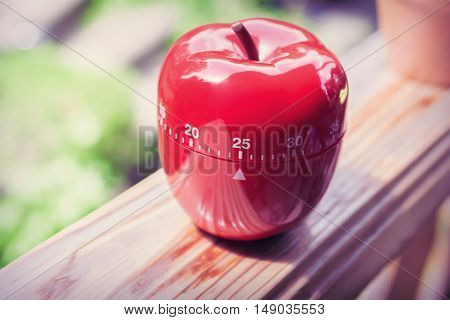 25 Minute Kitchen Egg Timer in Apple Shape Standing On A Handrail
