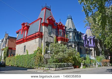 MONTREAL CANADA 09 24 2016: Typical Saint Louis Square row of colored townhouse in Montreal