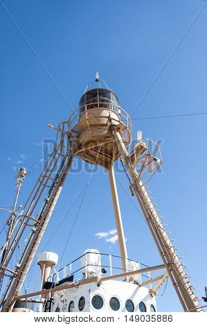New Bedford Massachusetts USA - September 25 2016: Light tower rising from deck of decommissioned Nantucket lightship