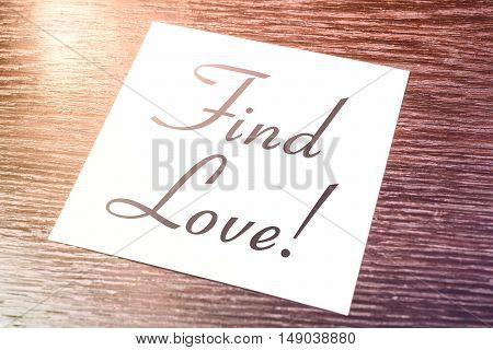 Find Love Reminder On Paper Lying On Wooden Cupboard