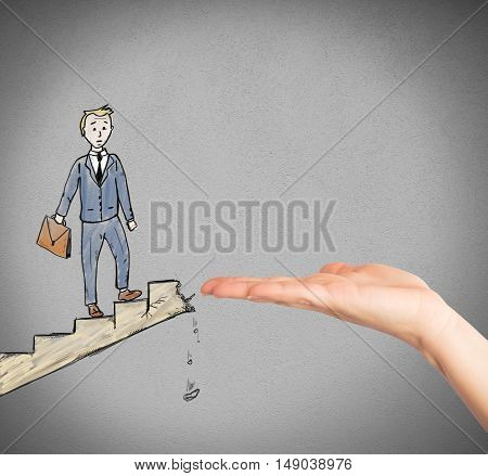 Businessman on a scale landslide helped by a big hand