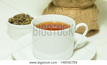 Close-up of oolong tea in cups with teapot
