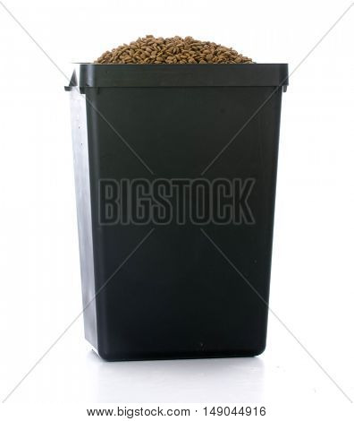stroage bin full of dog kibble food isolated on white background
