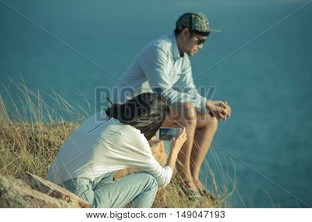 Couples Of Younger Man And Woman Taking Photo By Smart Phone
