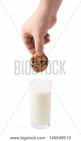 Glass of milk and a hand with cookie composition isolated over the white background