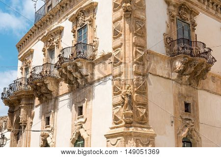 An old baroque palace seen in the village of Scicli in Sicily, Italy