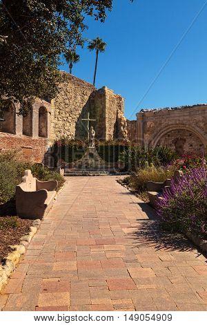 San Juan Capistrano, CA, USA --September 25, 2016: Statue of  Fray Junipero Serra at the Mission San Juan Capistrano in Southern California, United States. Editorial use only.