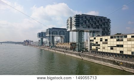 A view of Crane houses (Kranhäuser) located on the Rhine in Cologne. The buildings were designed by  architect Alfons Linster and Hamburg-based Hadi Teherani of BRT Architekten