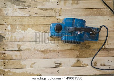 wood planers machine and wood chips background