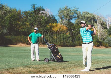 Two golfers during the game, toned image, horizontal image