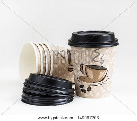 paper cup for drinks disposable utensils on a white background recycled material degradable in nature environmental protection