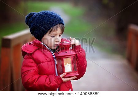 Sweet Child, Holding Red Lantern In The Park On A Sunny Winter Day