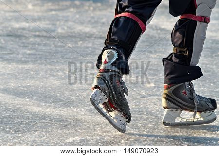 Skates On Player Feet During Ice Hockey